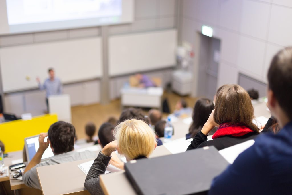 students sitting in a lecture theatre at univesity